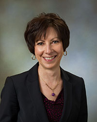 Kathryn M. Austin, President and Chief Executive Officer, Community Bancorp. and Community National Bank